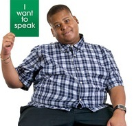 Boy holding card with written I want to speak